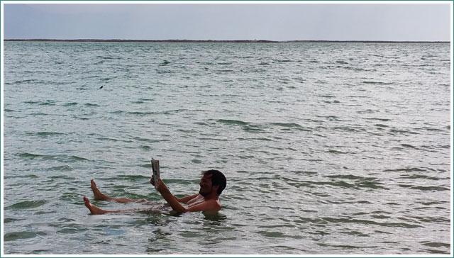 Reading a Newspaper - Dead Sea
